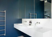 Sparkling contemporary bathroom in dark blue and white