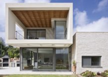 Stone and steel base of the lower level allows for the creating of a striking overhang above