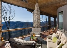 Stone pillars and fireplace give the beautiful deck a rustic touch