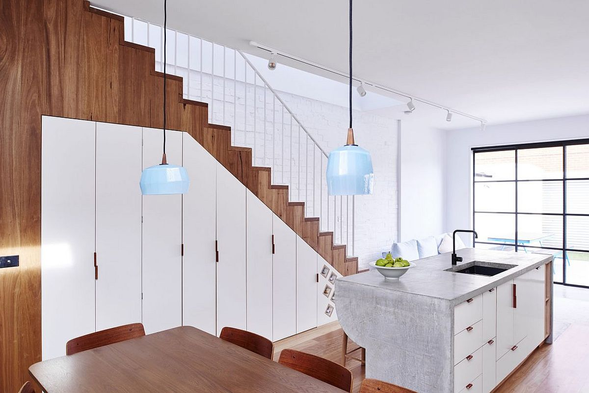 Storage space under the staircase with a series of cabins
