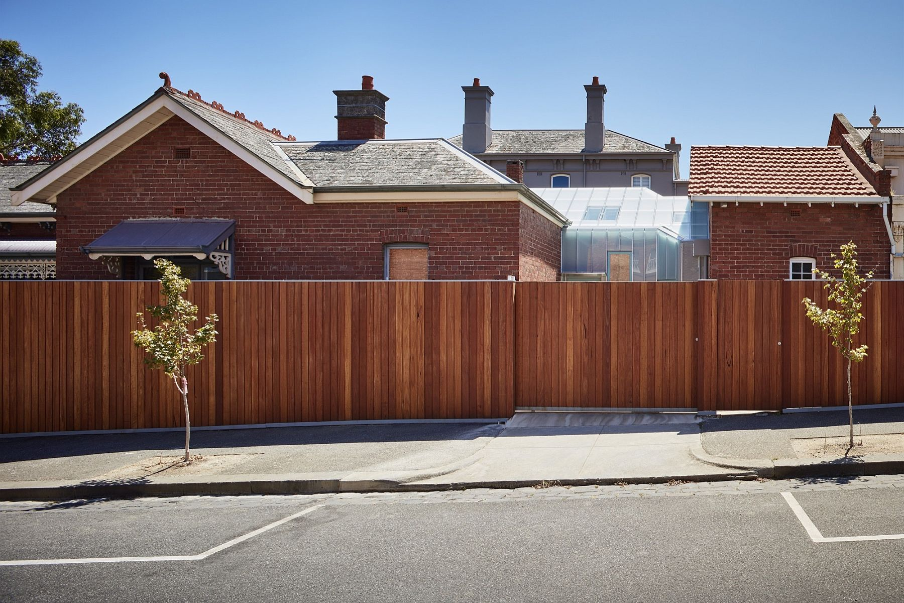 Street view of the transformed home in Melbourne with brick facade Parkville Residence: Eloquent Simplicity Stitches Together Modern and Classic