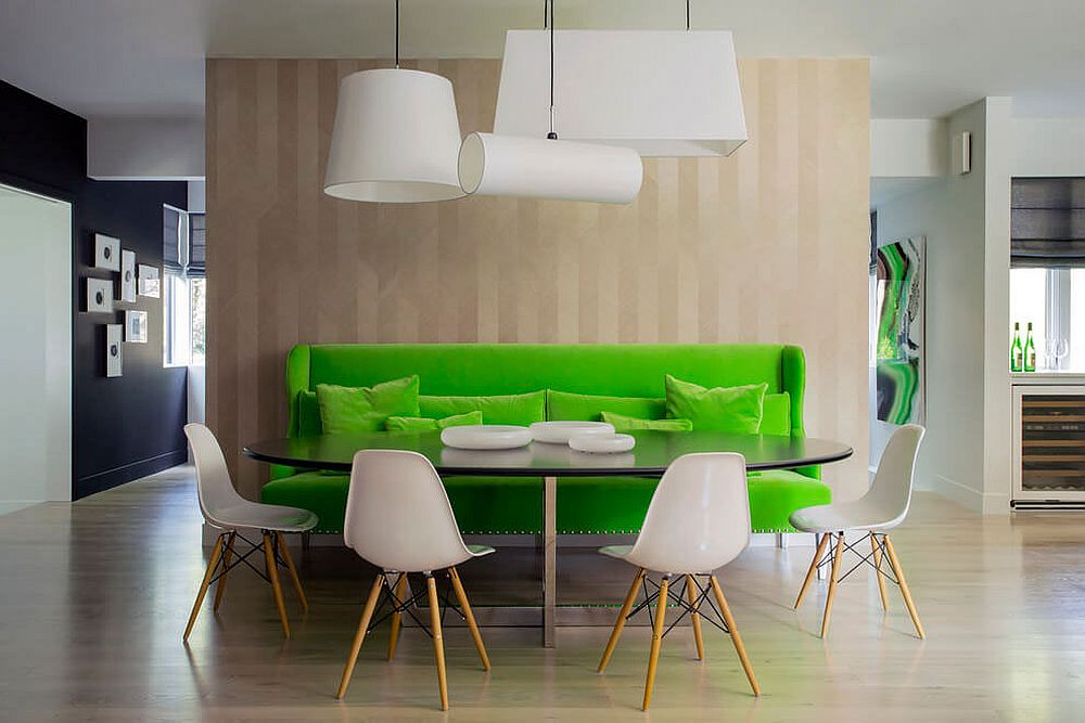 Striking green bench defines the dining area