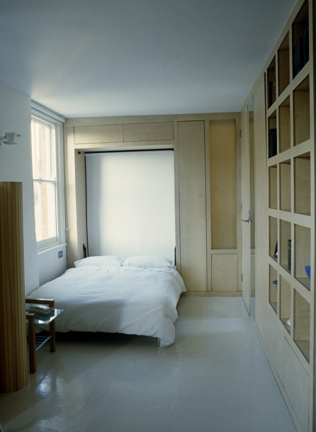 Studio apartment with a Murphy bed (photo via Lonny)