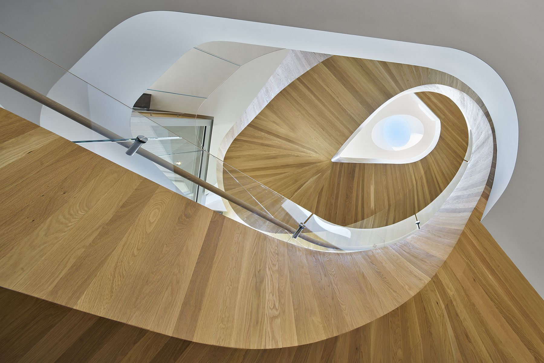 Stunning helical staircase adds grandeur to the interior