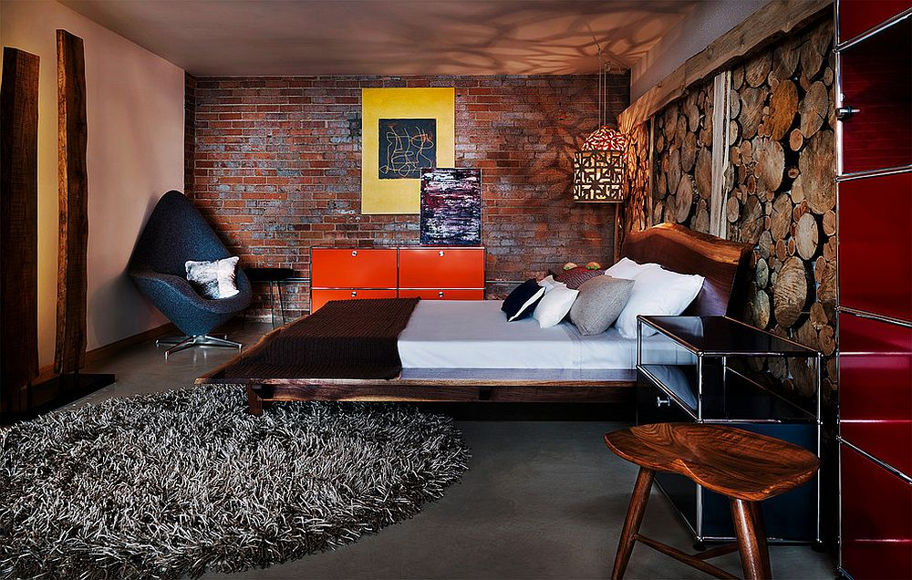 Stunning industrial bedroom with live-edge headboard and unique accent wall [Design: James Maynard- Vantage Imagery]