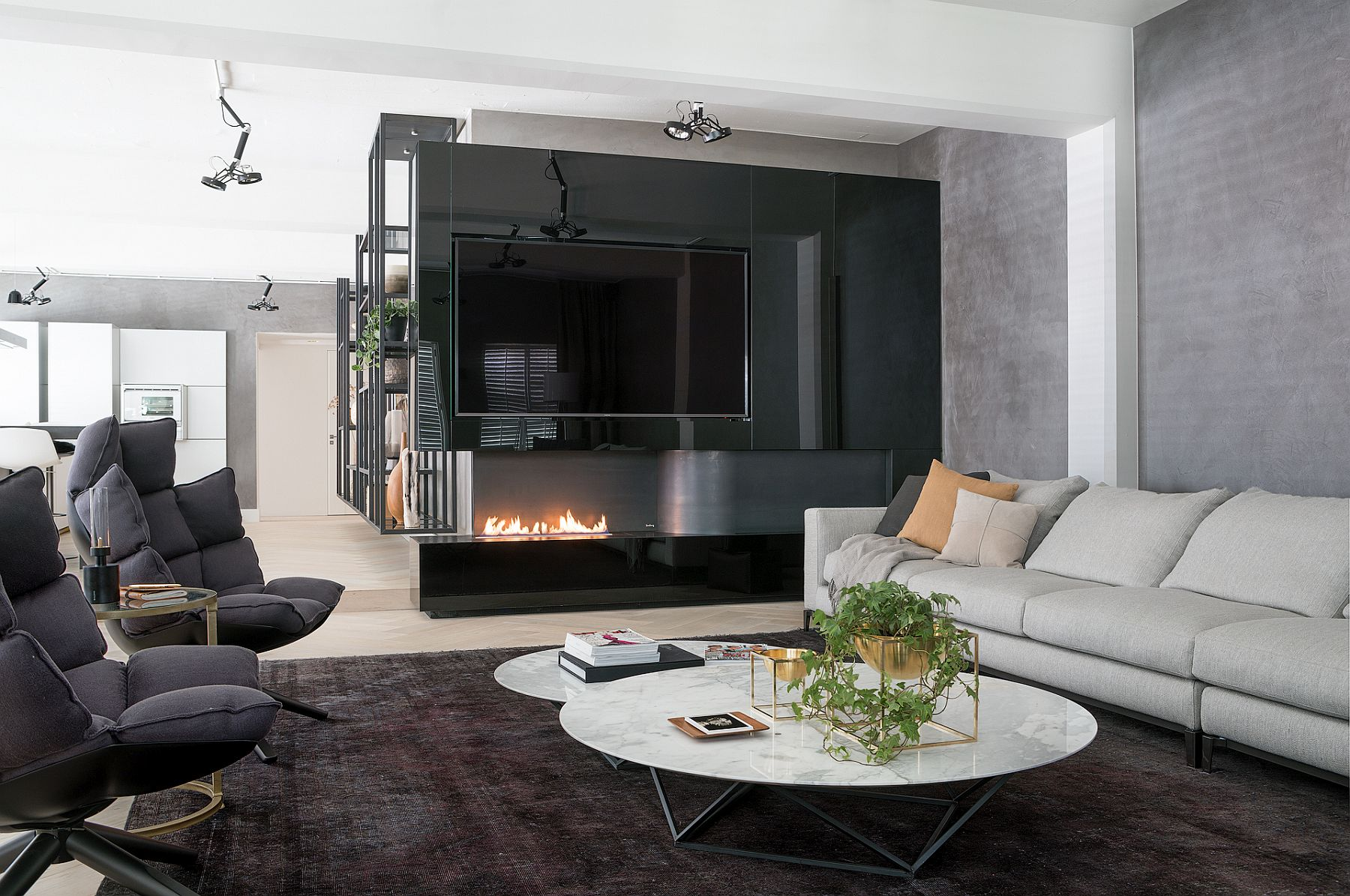 Stunning use of fireplace in the living room with 80-inch TV above it