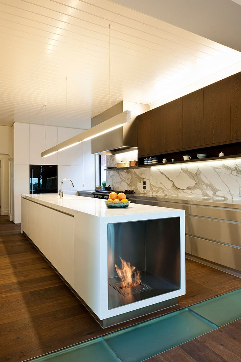 Stylish contemporary kitchen with fireplace built into the island [Design: EcoModern Design]