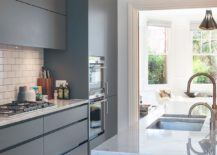 Stylish modern kitchen in shades of bluish-gray and white is an absolute showstopper