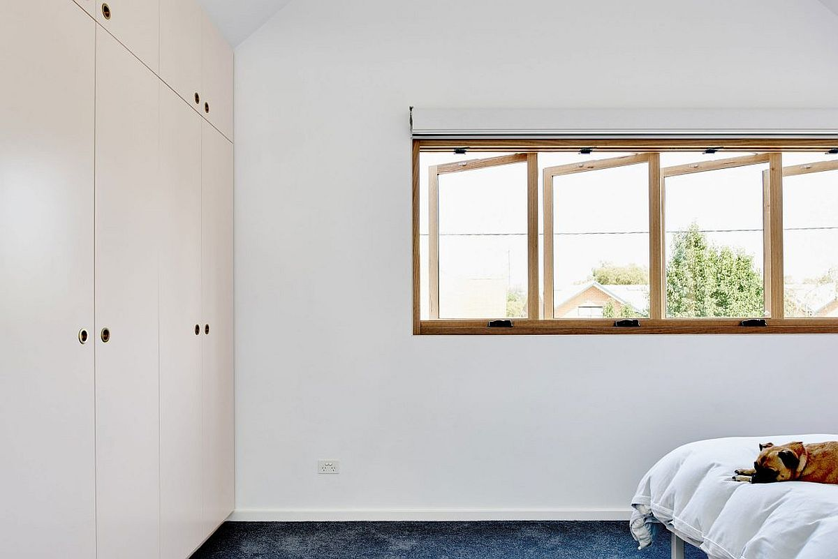 Swiveling windows bring in natural freshness into the bedroom