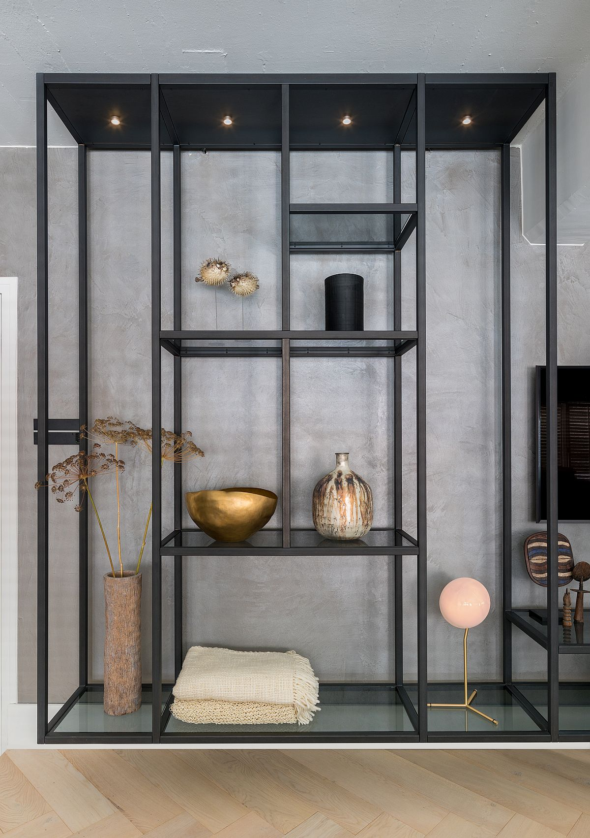 Tall industrial shelves were crafted to fit in with the scale and style of the contemporary loft