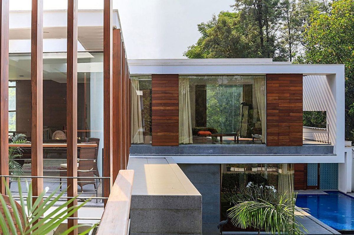 Top level of contemporary home in India with expansive deck and bedrooms