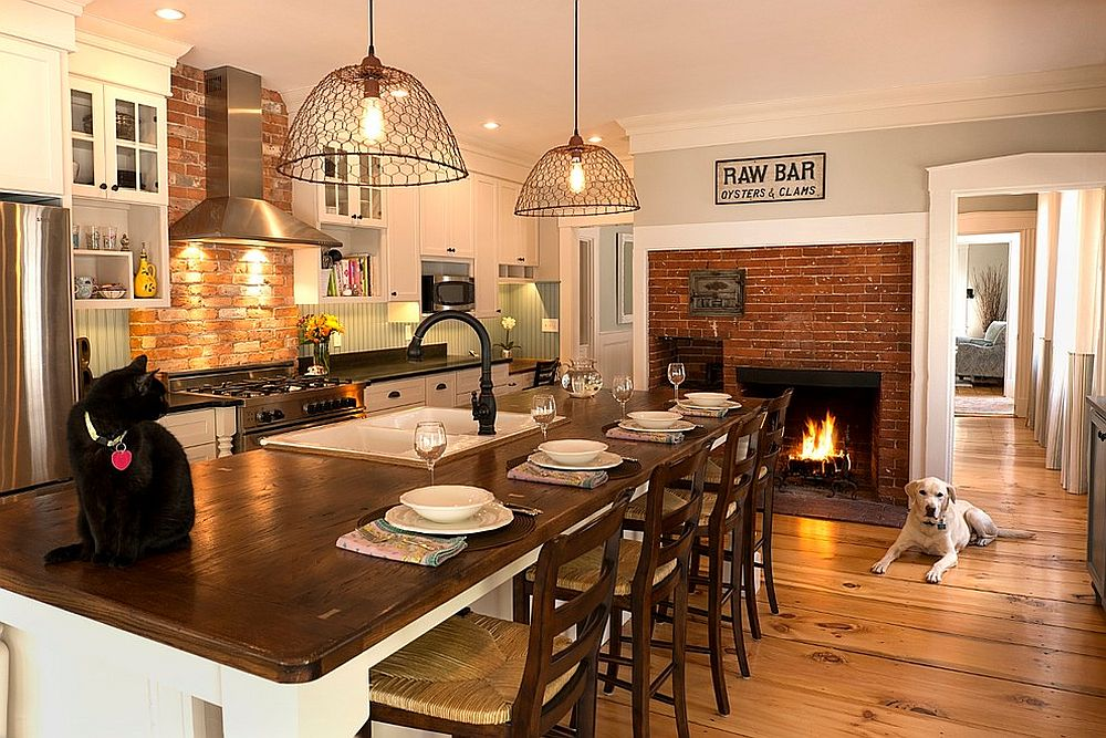 Traditional brick fireplace serves both the kitchen and the breakfast zone