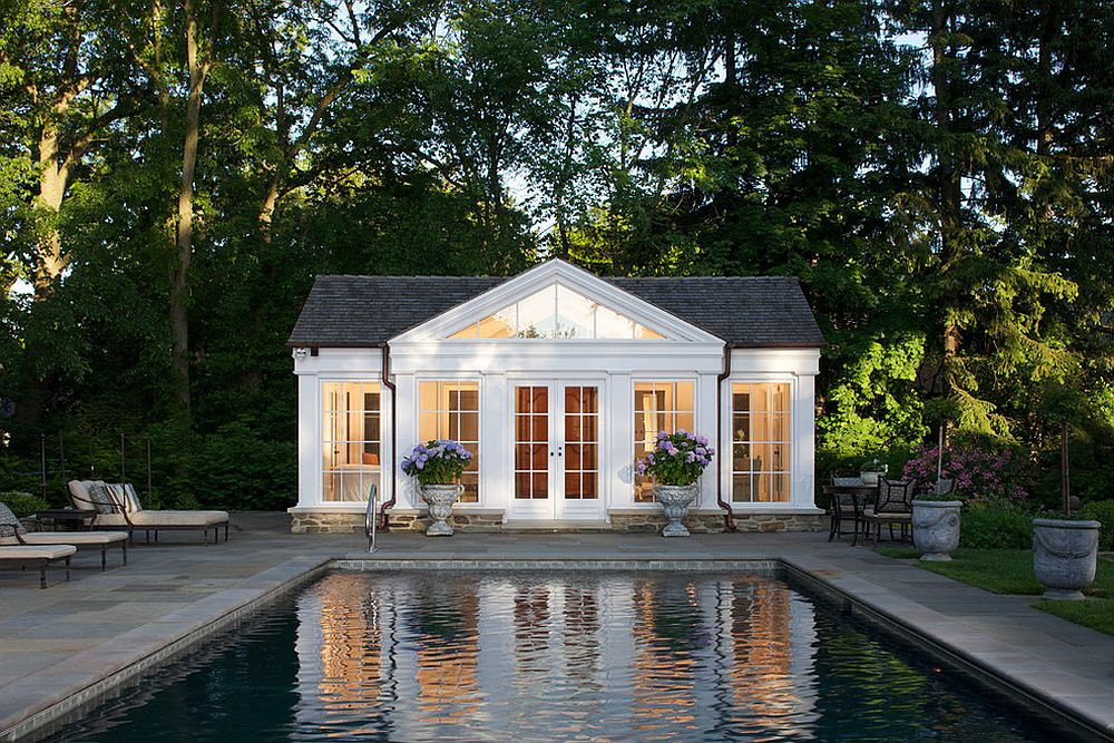 traditional pool house in white with gray shingled roof design northworks architects and planners