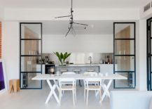 White dining table and chair set blends into the backdrop effortlessly