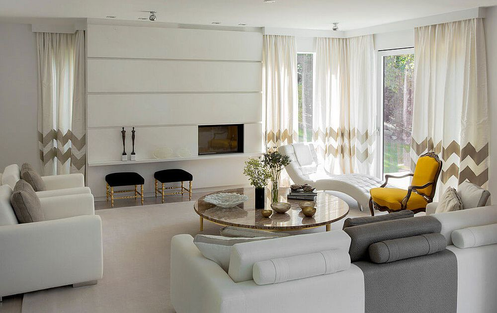 White is the color of choice in the spacious living room with chevron pattern curtains