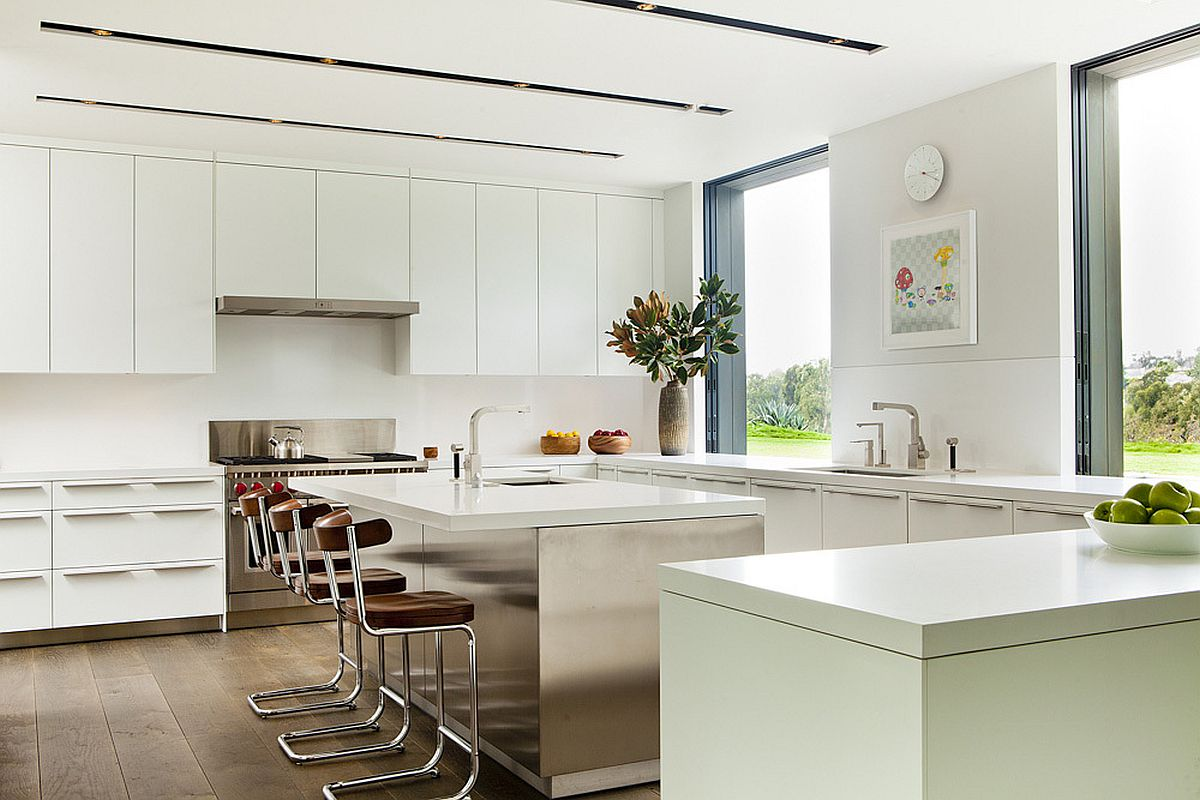 White kitchen design with a spacious central island and breakfast bar