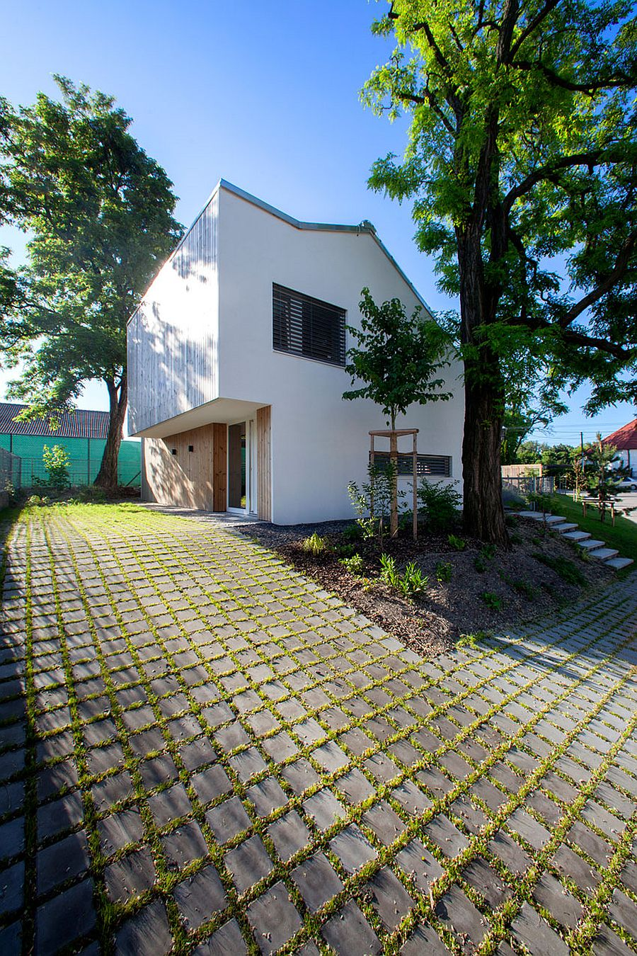 White plaster, wood and glass home on a raised lot in Slovakia