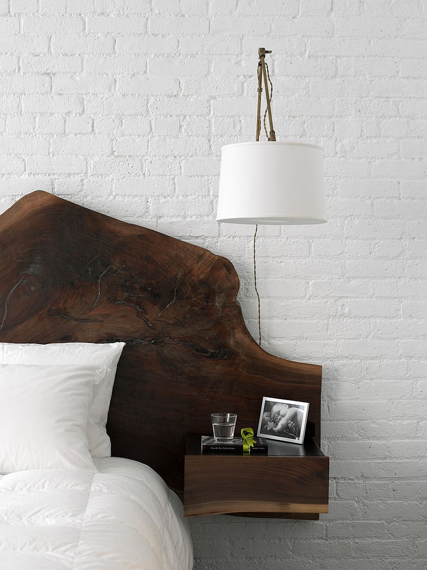 Whitewashed brick wall backdrop for the modern bedroom with woodsy bed [Design: Schappacher White Architecture]