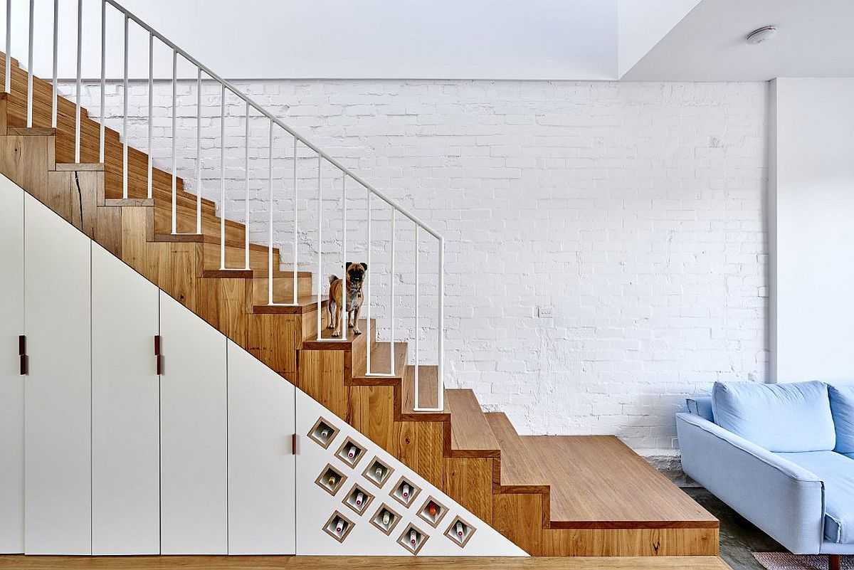 Wine storage and additional storage shelves under the staircase