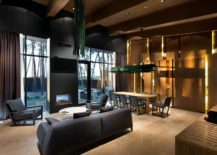 Wood-stone-and-plush-surfaces-create-an-inviting-and-modern-interior-217x155