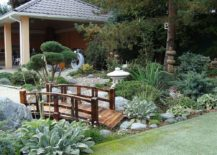 Wooden bridge gives the Asian garden that timeless Japanese style and Oriental vibe 217x155 Oriental Landscape: 20 Asian Gardens That Offer a Tranquil Green Haven