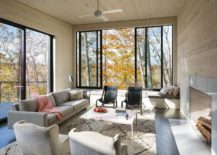 Woods outside become a part of the living room visual 217x155 Design That Connects with Nature: Dark and Dashing James River House