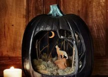 A haunting scence crafted using pumpkin with a cool diorama