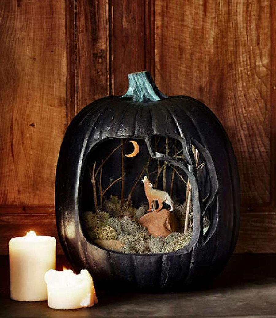 A haunting scene crafted using pumpkin with a cool diorama [From: Country Living]