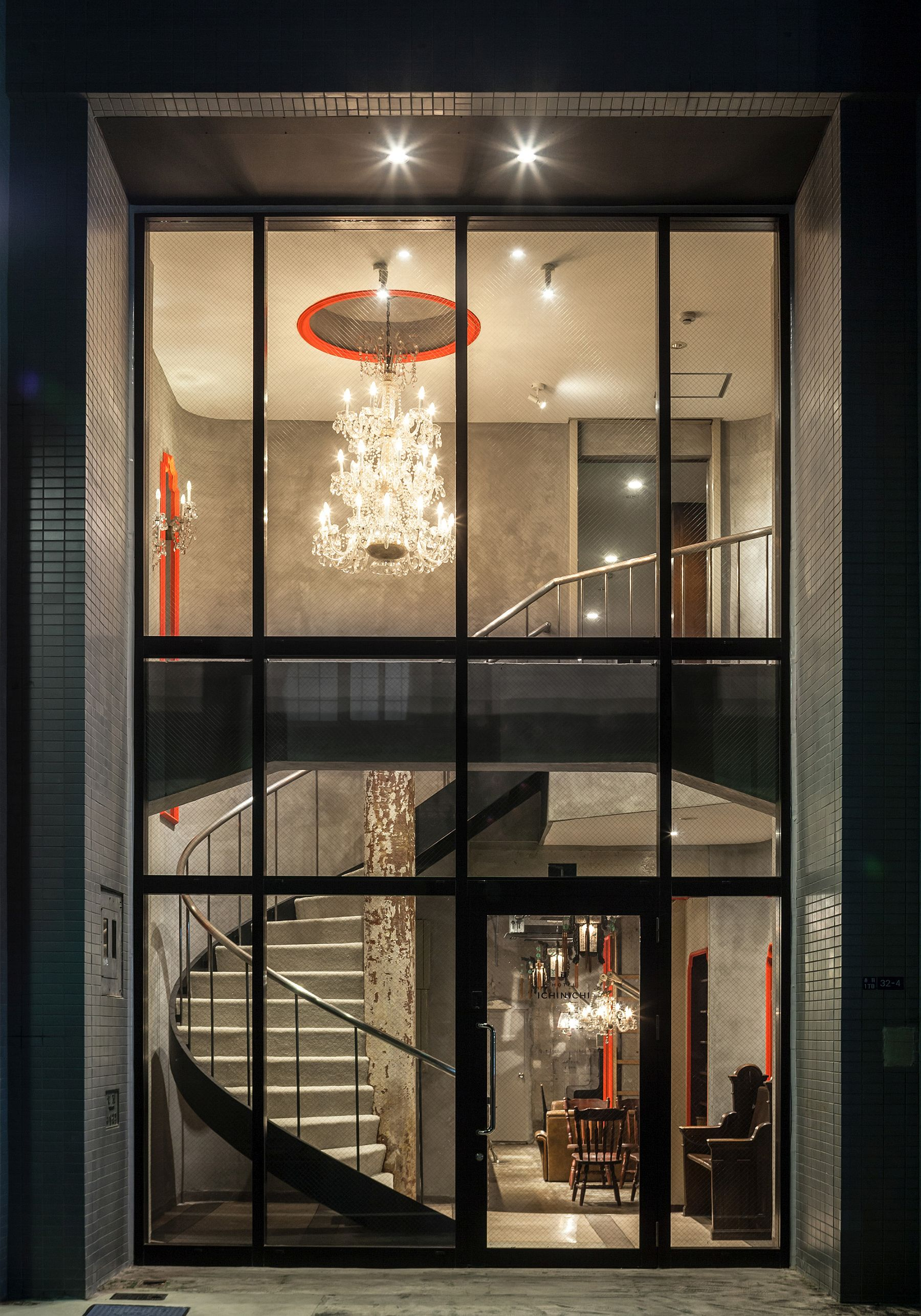 A stunning view of the entry with spiral staircase and grand chandelier