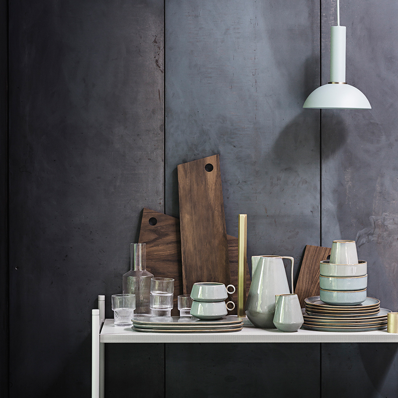 A wooden cutting board vignette from ferm LIVING