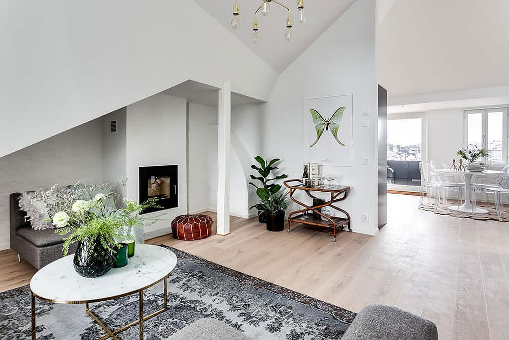 Attic apartment design with open living room and dining area Small Attic Apartment in Stockholm turns to Light Filled Scandinavian Style