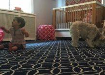 Black rug in the nursery grabs attention despite leaving the color scheme undisturbed