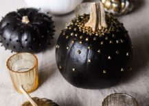 Black surely brings Halloween vibe to pumpkin decoration