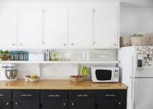 Brass knobs and pulls in a kitchen makeover
