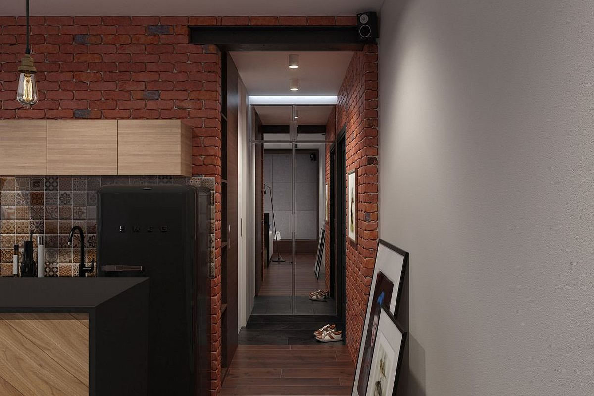 Brick, wood and natural stone shape the stylish and space-savvy bachelor loft