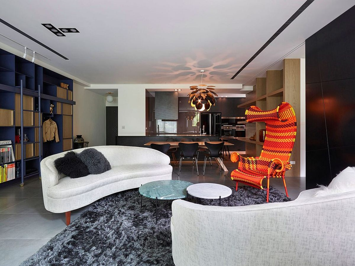 Bright chairs add color to the living area Sojourn: Contemporary Taipei Residence in Black, White and Gray