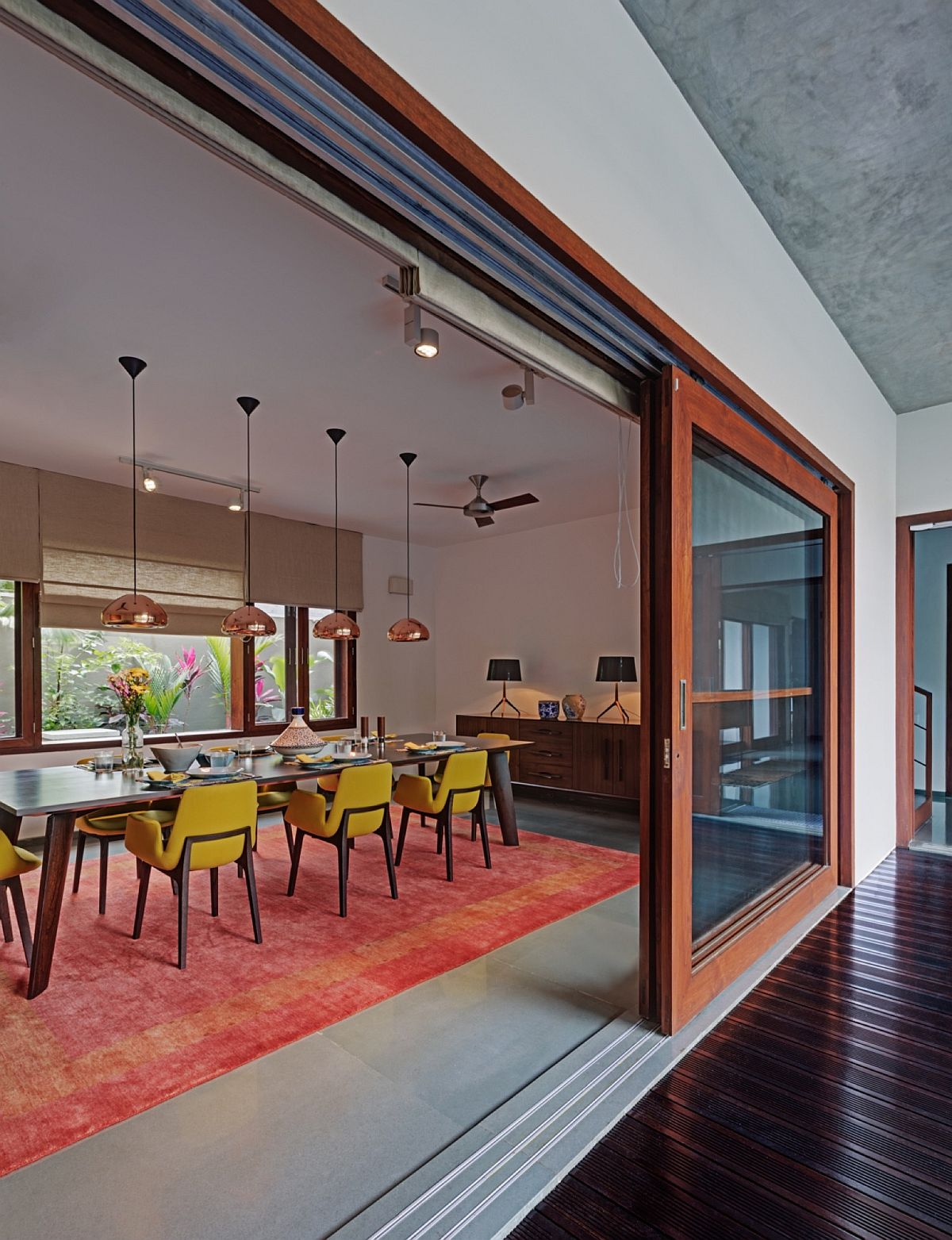 Brightly colored rug in orangish-pink for the dining room