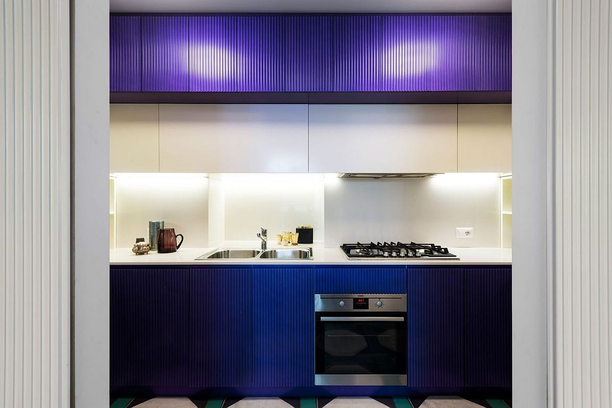 Cabinets give the kitchen a bright, blue visual appeal