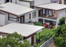 Cantilevered timber clad trapezoidal roof forms fashion a luxury home in Banjara Hills, Hyderabad