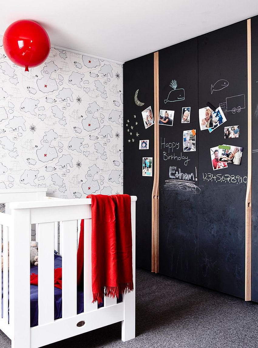 Chalkboard wall is the perfect way to add color to the contemporary nursery [Design: Atticus & Milo]