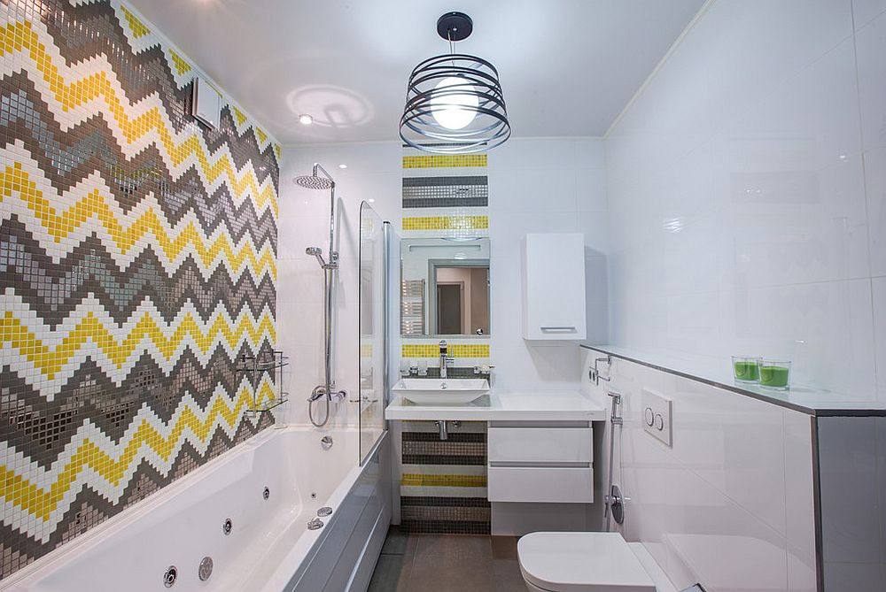 Chevron patterned tile design in yellow and gray create a striking bathroom [Design: Eugene Shimkevich]