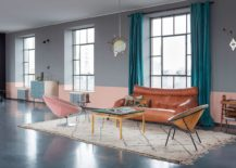 Chic and retro touches in the living room are accentuated by pastel pink and gray 217x155 Loft 19: From an Old Weapon Factory to a Quirky Modern Home