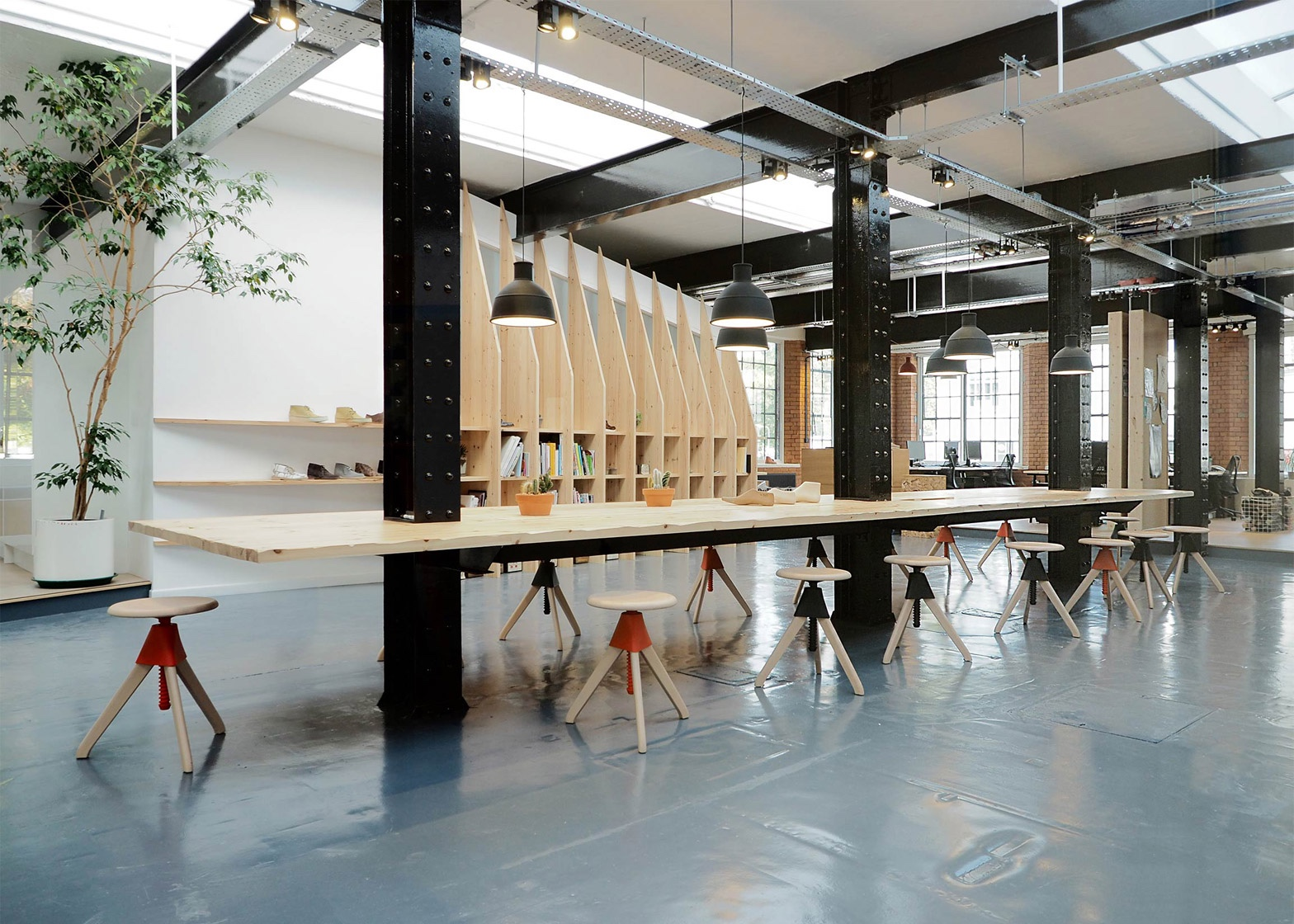 Paris-based ARRO Studio transformed a 19th-century warehouse into a modish design studio for trusted British shoe brand Clarks. Image via Dezeen.
