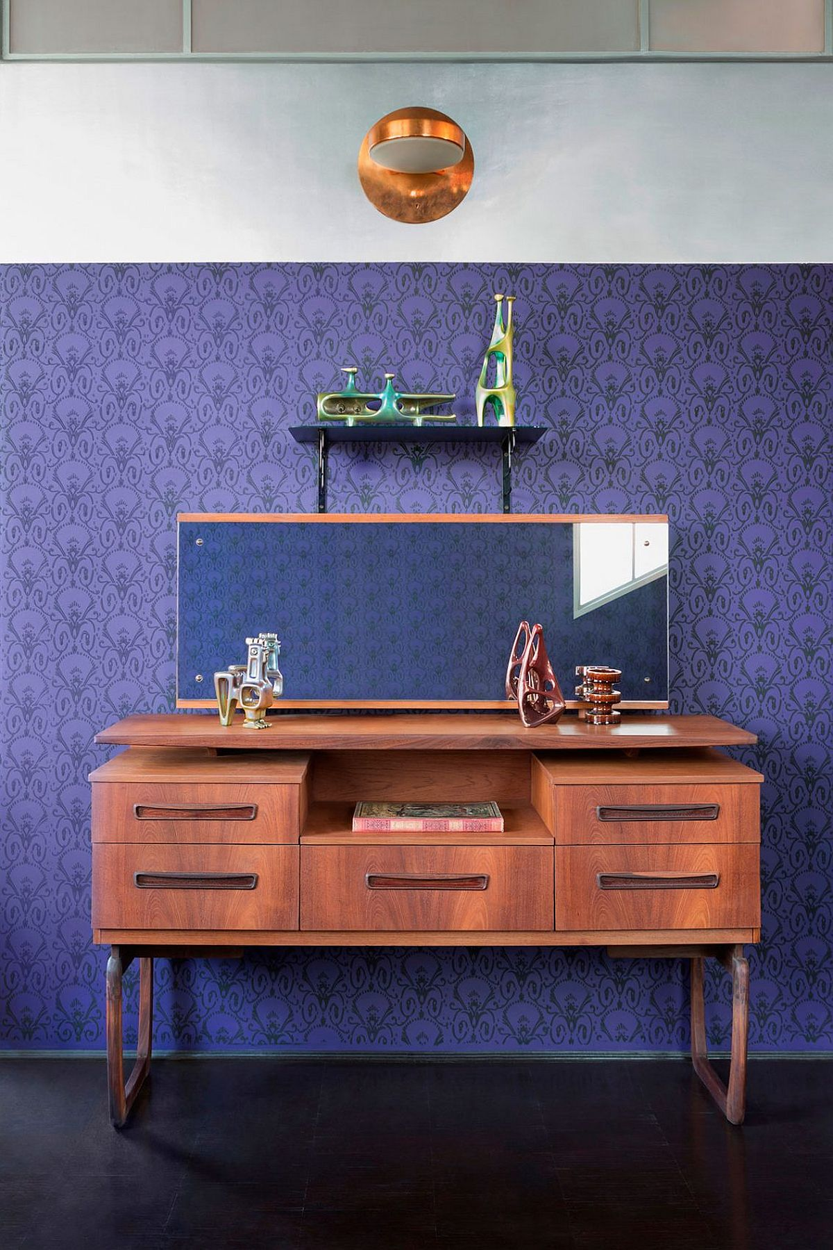 Classic bedroom dressign table and mirror with a bright purple backdrop