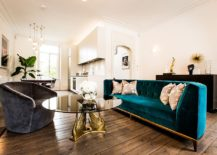 Classic midcentury living room with couch in velvety blue and gold