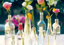 Clear-glass-bottles-filled-with-flowers-217x155