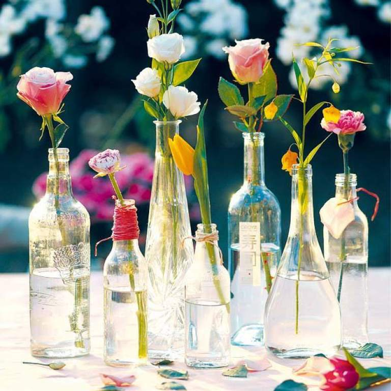 Clear glass bottles filled with flowers