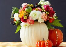 Colorful blend of flowers and pumpkins creates a stunning centerpiece