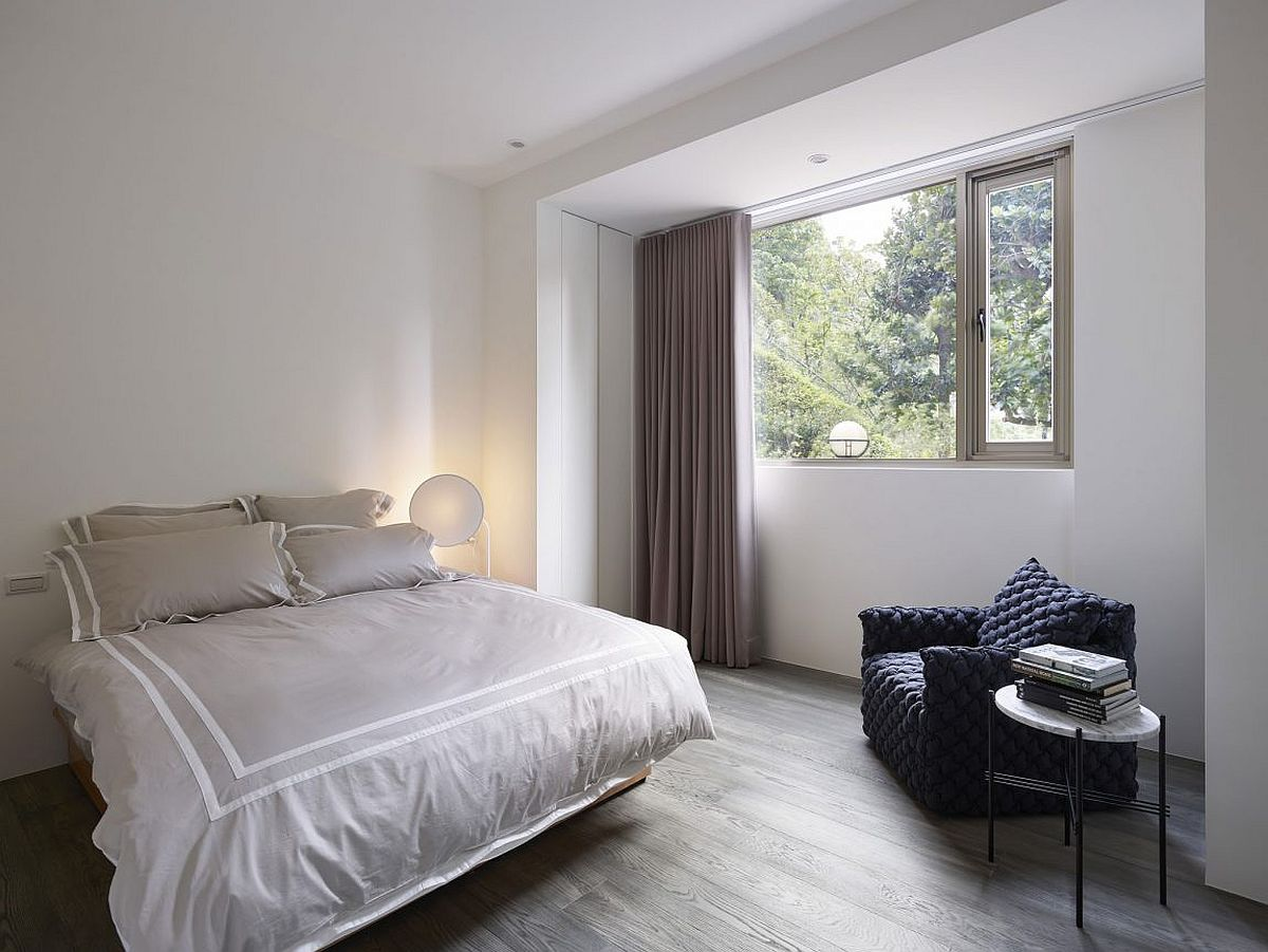 Comfy decor and bright light give the bedroom a breezy ambiance