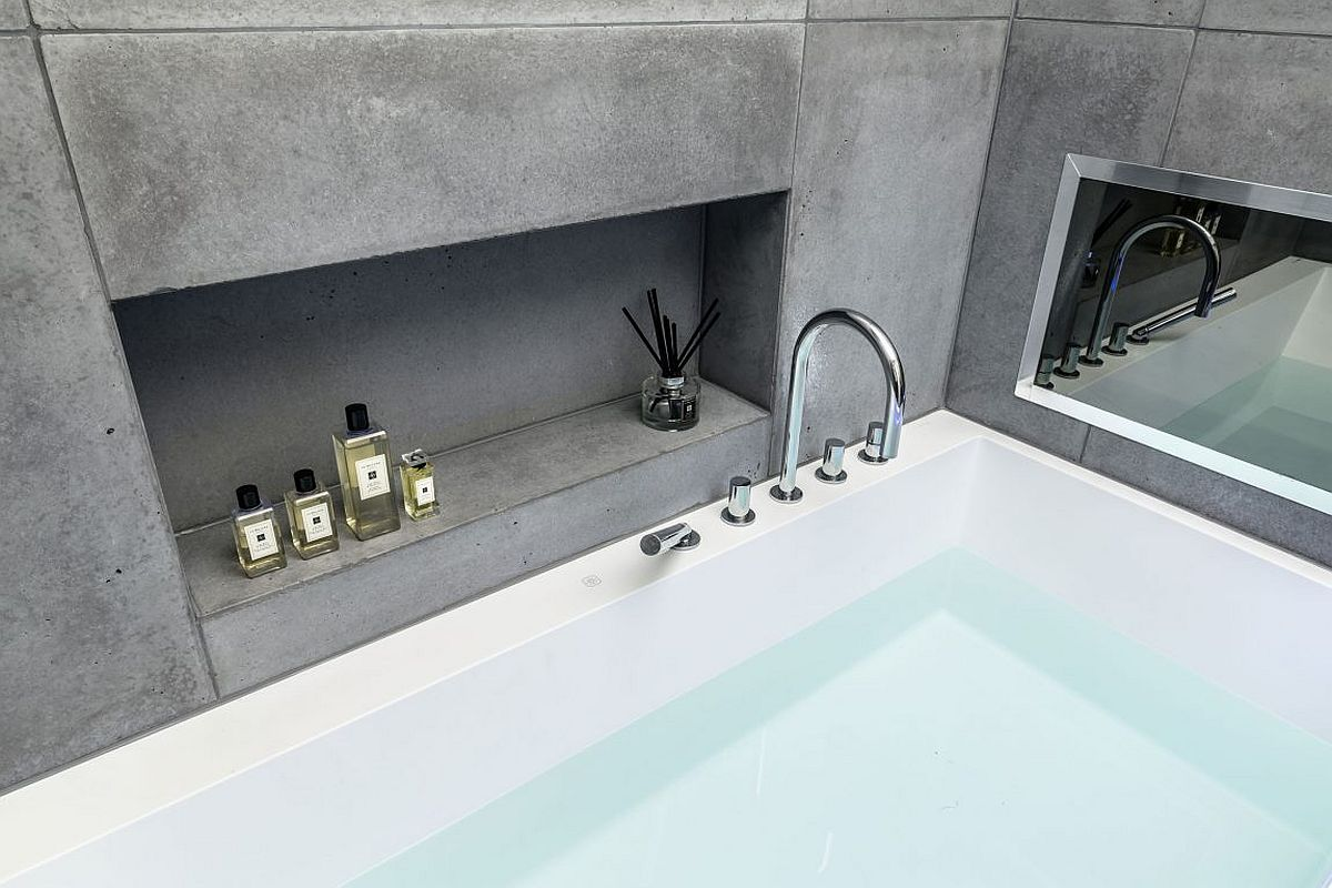 Concrete tiles and smart design create a soothing cotemporay bathroom inside the London penthouse